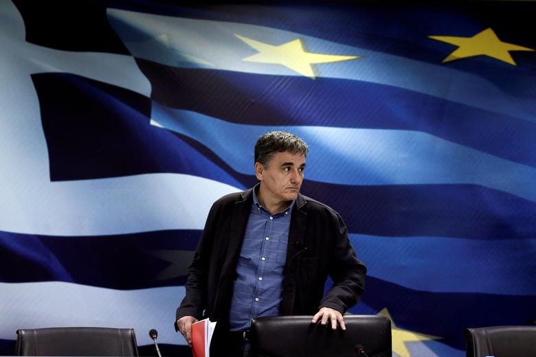 FILE PHOTO: Greek Finance Minister Euclid Tsakalotos arrives for a news conference at the ministry in Athens, Greece March 30, 2017. REUTERS/Alkis Konstantinidis/File Photo