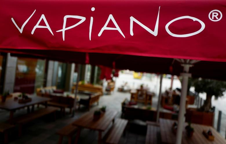 FILE PHOTO: The outside sitting area of a Vapiano restaurant is photographed in a shopping mall in the city of Hanau near Frankfurt, Germany, March 15, 2016.    REUTERS/Kai Pfaffenbach/ File Photo