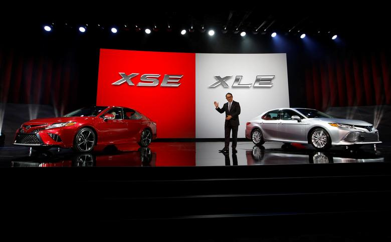 FILE PHOTO : Akio Toyoda, president of Toyota Motor Corporation, introduces the 2018 Camry XSE (L) and the 2018 Camry XLE during the North American International Auto Show in Detroit, Michigan, U.S., January 9, 2017.  REUTERS/Mark Blinch/File Photo