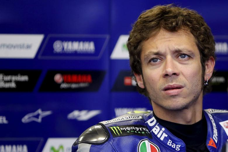 FILE PHOTO - Yamaha MotoGP rider Valentino Rossi of Italy is pictured in his team garage during the second free practice session of the French Grand Prix at the Le Mans circuit, in Le Mans, France May 16, 2015. REUTERS/Stephane Mahe/File Photo