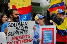Protesters demonstrate outside of Goldman Sachs headquarters after the company purchased Venezuelan bonds in New York. REUTERS/Lucas Jackson