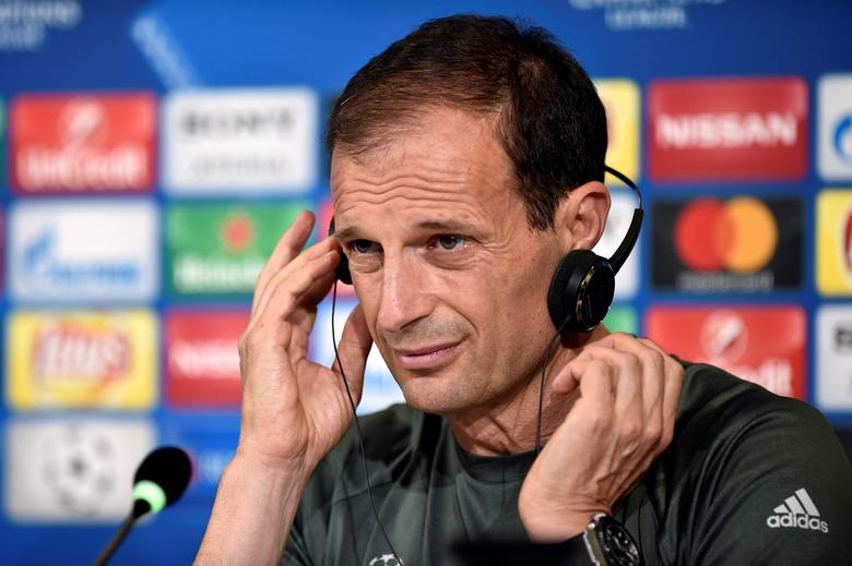 Football Soccer - Juventus news conference - UEFA Champions League Final - Juventus stadium, Turin, Italy - 29/5/17 - Juventus's coach Massimiliano Allegri uses headphones as he attends a news conference during the open media day. REUTERS/Giorgio Perottino
