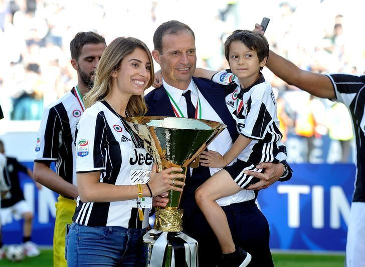 Football Soccer - Juventus v Crotone - Serie A - Juventus Stadium, Turin, Italy - 21/5/17Juventus coach Massimiliano Allegri celebrates with his family and the trophyReuters / Giorgio Perottino