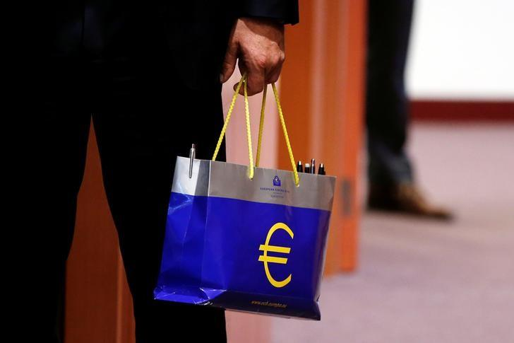 FILE PHOTO - An official holds a bag with the euro logo during a eurozone finance ministers meeting in Brussels, Belgium May 22, 2017. REUTERS/Francois Lenoir
