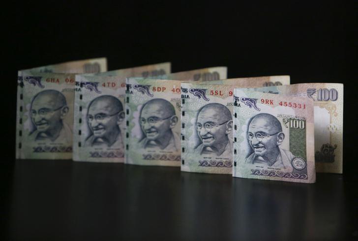 Indian Rupee notes are seen in this picture illustration taken in Mumbai June 12, 2013. REUTERS/Vivek Prakash/Files