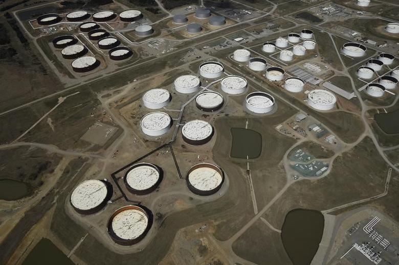 FILE PHOTO: Crude oil storage tanks are seen from above at the Cushing oil hub, in Cushing, Oklahoma, U.S., in this March 24, 2016.  REUTERS/Nick Oxford/File Photo