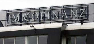 The logo of Austrian property group Immofinanz is seen on the rooftop of an office building in Vienna April 2, 2015. Austrian property group CA Immo sees an imminent change at the top of bigger rival Immofinanz as a potential way out of a heated real estate battle, paving the way for the creation of a central European real estate powerhouse. REUTERS/Heinz-Peter Bader
