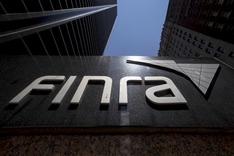 A sign for the Financial Industry Regulatory Authority (FINRA) is seen outside the offices in New York's financial district July 22, 2015.  REUTERS/Brendan McDermid