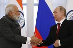 Russian President Vladimir Putin (R) and Indian Prime Minister Narendra Modi shake hands after making a statement on the sidelines of the St. Petersburg International Economic Forum (SPIEF), Russia, June 1, 2017. REUTERS/Grigory Dukor