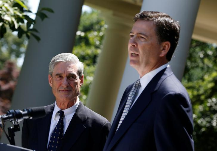 FILE PHOTO: James Comey (R), a Republican who served in the Bush Justice Department, speaks alongside outgoing FBI Director Robert Mueller after being nominated by U.S. President Barack Obama (not pictured) to replace Mueller, in the Rose Garden of the White House in Washington, June 21, 2013.  REUTERS/Jason Reed/File Photo