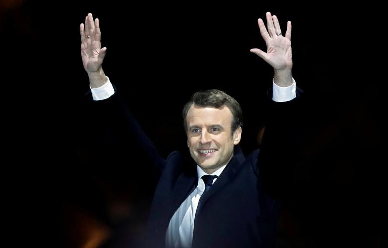 FILE PHOTO: French President-elect Emmanuel Macron celebrates on the stage at his victory rally near the Louvre in Paris, France May 7, 2017. REUTERS/Christian Hartmann/File Photo