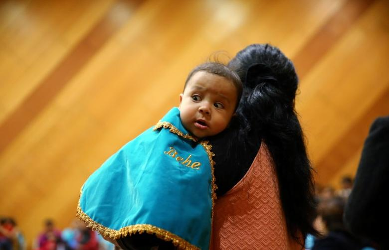 A mother and baby attend a breastfeeding contest organized by Peru's Health Ministry in Lima, Peru, August 26, 2016. REUTERS/Mariana Bazo