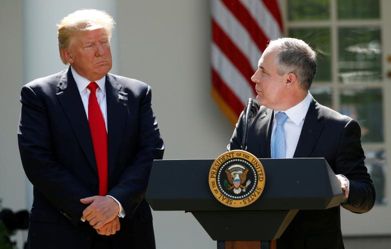 U.S. President Donald Trump (L) listens to EPA Administrator Scott Pruitt after announcing his decision that the United States will withdraw from the Paris Climate Agreement, in the Rose Garden of the White House in Washington, U.S., June 1, 2017. REUTERS/Kevin Lamarque
