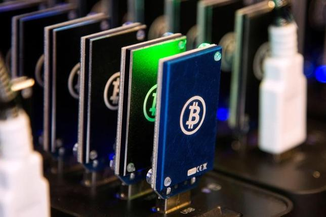 FILE PHOTO: A chain of block erupters used for Bitcoin mining is pictured at the Plug and Play Tech Center in Sunnyvale, California October 28, 2013.  REUTERS/Stephen Lam/File Photo