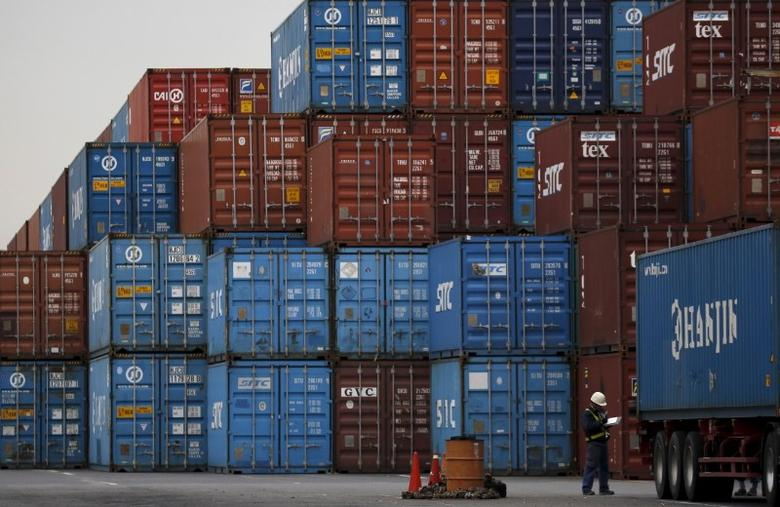 FILE PHOTO: A laborer works in a container area at a port in Tokyo, Japan, March 16, 2016.   REUTERS/Toru Hanai