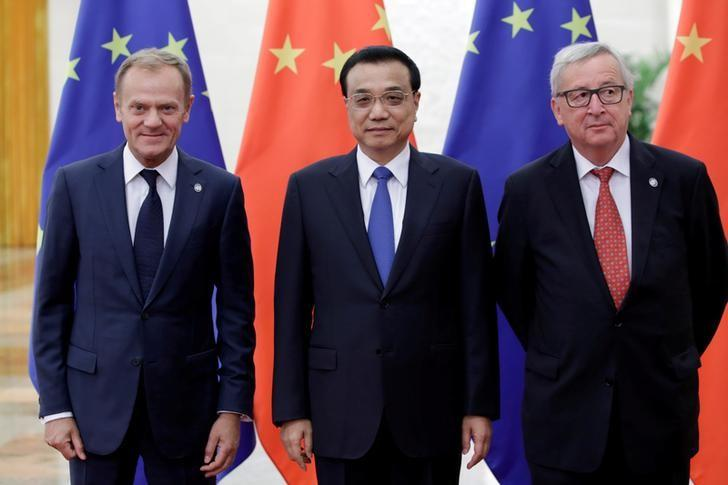 FILE PHOTO: China's Premier Li Keqiang (C) meets European Commission President Jean-Claude Juncker (R) and European Council President Donald Tusk during the China-EU summit at the Great Hall of the People in Beijing, China, July 12, 2016. REUTERS/File Photo