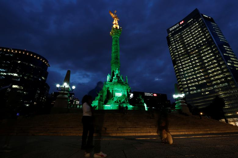 Green lights are projected at the Angel of Independence monument in support in the Paris Climate Agreement, after U.S. President Donald Trump announced his decision that the United States will withdraw from the Paris Agreement in Mexico City, Mexico June 1, 2017.  REUTERS/Carlos Jasso