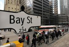 The Bay Street sign is pictured in the heart of the financial district as people walk by in Toronto, May 22, 2008.     REUTERS/Mark Blinch