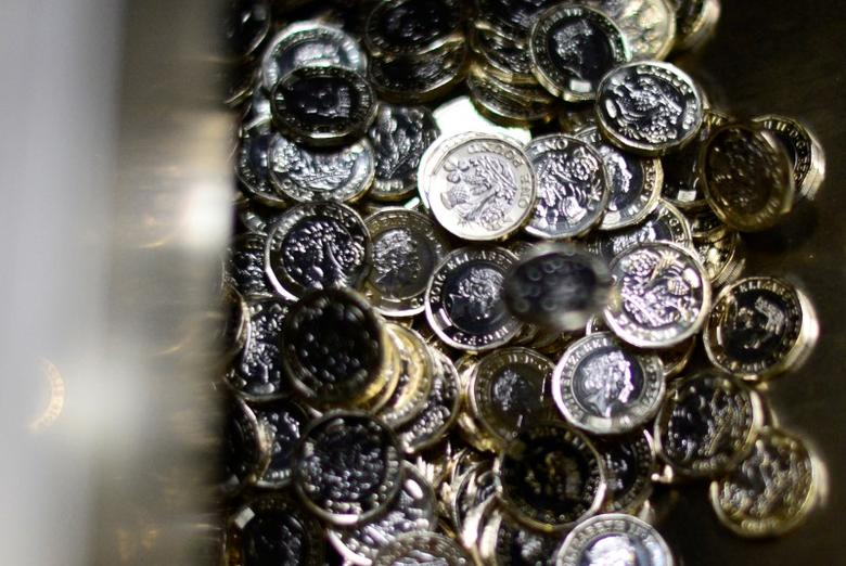 FILE PHOTO: New one pound coins come off the production line at The Royal Mint in Llantrisant, Wales, Britain, January 25, 2017.  REUTERS/Rebecca Naden/File Photo