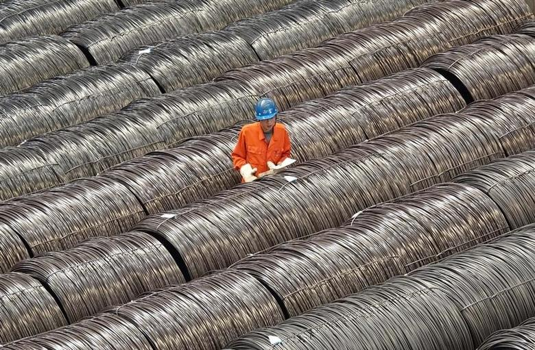 A worker checks steel wires at a warehouse in Dalian, Liaoning province, China May 15, 2017. REUTERS/Stringer