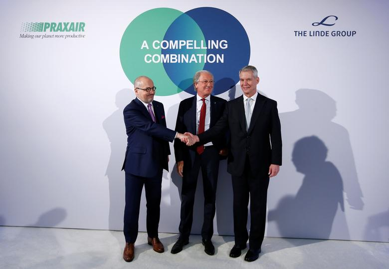 Praxair Chief Executive Officer Steve Angel (R-L), Linde Chairman of the Board Wolfgang Reitzle and Linde CEO Aldo Belloni arrive for a news conference in Munich, Germany June 2, 2017. REUTERS/Michaela Rehle