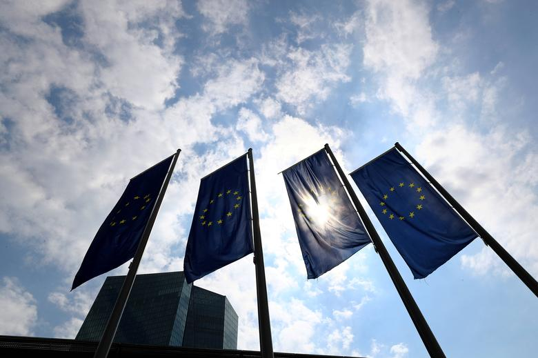 FILE PHOTO: Flags in front of the European Central Bank (ECB) before a news conference at the ECB headquarters in Frankfurt, Germany, April 27, 2017.  REUTERS/Kai Pfaffenbach/File Photo