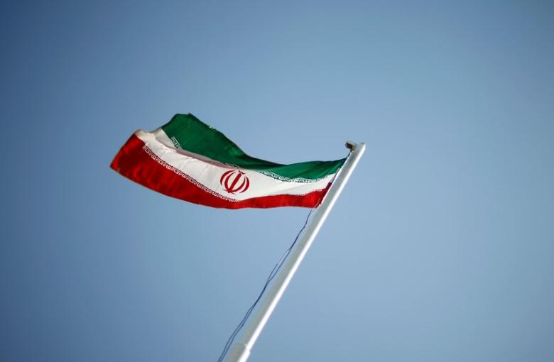 FILE PHOTO: An Iranian national flag flutters in Tehran April 15, 2011.  REUTERS/STR/File Photo
