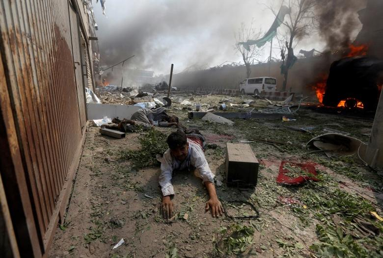 A wounded man lies on the ground at the site of a blast in Kabul, Afghanistan May 31, 2017. REUTERS/Omar Sobhani
