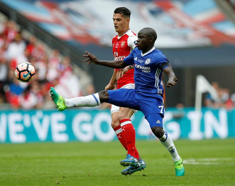 Britain Soccer Football - Arsenal v Chelsea - FA Cup Final - Wembley Stadium - 27/5/17 Chelsea's N'Golo Kante in action with Arsenal's Granit Xhaka Reuters / Andrew Yates EDITORIAL USE ONLY. No use with unauthorized audio, video, data, fixture lists, club/league logos or ''live'' services. Online in-match use limited to 45 images, no video emulation. No use in betting, games or single club/league/player publications.  Please contact your account representative for further details.