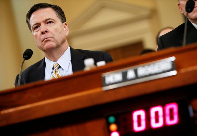 FILE PHOTO: FBI Director James Comey testifies before the House Intelligence Committee hearing into alleged Russian meddling in the 2016 U.S. election, on Capitol Hill in Washington, U.S., March 20, 2017. REUTERS/Joshua Roberts/File Photo