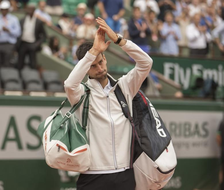 Jun 2, 2017; Paris, France; Novak Djokovic (SRB) celebrates match point during his match against Diego Schwartzman (ARG) (not pictured) on day six of the 2017 French Open tennis tournament at Stade Roland Garros. Mandatory Credit: Susan Mullane-USA TODAY Sports
