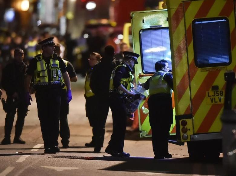 Police officers speak with ambulance personnel after an incident near London Bridge in London, Britain June 4, 2017. REUTERS/Hannah Mckay