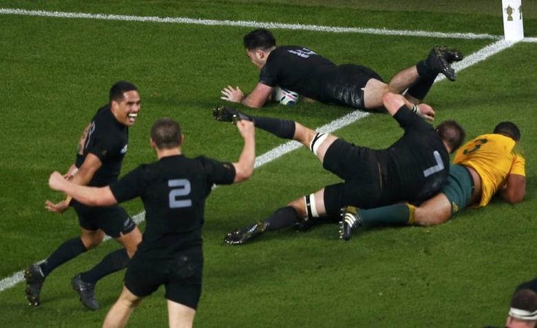 Nehe Milner-Skudder of New Zealand (top) scores a try against Australia during their Rugby World Cup Final at Twickenham in London, October 31, 2015. REUTERS/Eddie Keogh