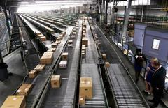 Conveyors are seen at a Wal-Mart Stores Inc distribution centers in Bentonville, Arkansas June 6, 2013. REUTERS/Rick Wilking/File Photo  GLOBAL BUSINESS WEEK AHEAD PACKAGE Ð SEARCH ÒBUSINESS WEEK AHEAD JULY 4Ó FOR ALL IMAGES - RTX2JK7F