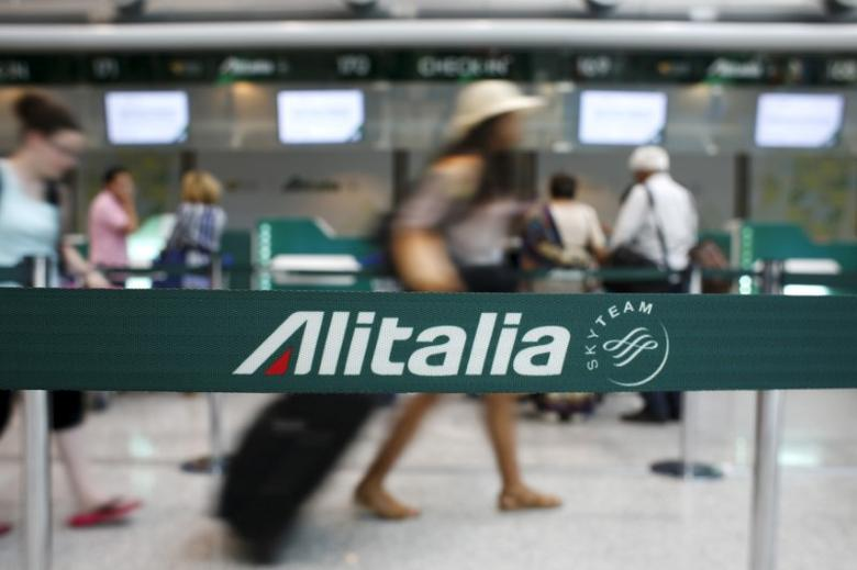 FILE PHOTO: People walk in the Alitalia departure hall during a strike by Italy's national airline Alitalia workers at Fiumicino international airport in Rome, Italy July 24, 2015. REUTERS/Max Rossi/File Photo