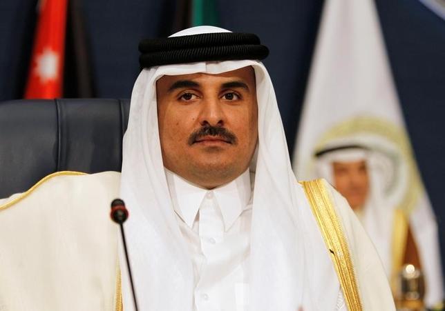 6月6日、サウジアラビアなど中東の主要国がカタールとの国交を断絶したことを受け、カタールのムハンマド外相は、調停を通じた解決に努める用意があると表明した。写真はカタールのタミム首長、2014年3月クウェートで撮影(2017年 ロイター/Hamad I Mohammed)