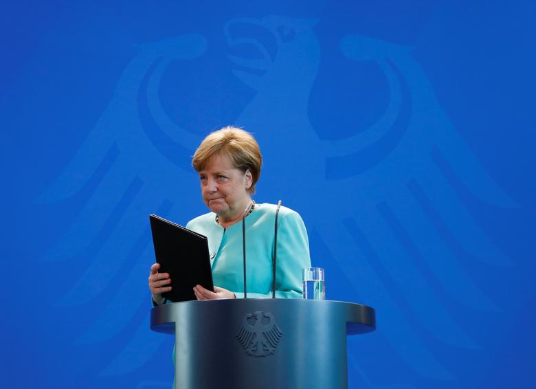 German Chancellor Angela Merkel delivers a statement about Trump's global climate deal announcement at the Chancellory in Berlin, Germany, June 2, 2017.    REUTERS/Fabrizio Bensch