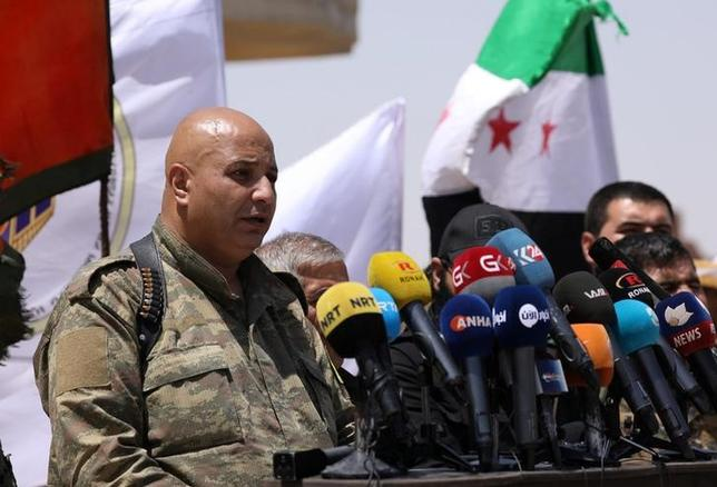 Syrian Democratic Forces (SDF) spokesman Talal Silo speaks during a press conference in Hukoumiya village in Raqqa, Syria June 6, 2017.REUTERS/Rodi Said