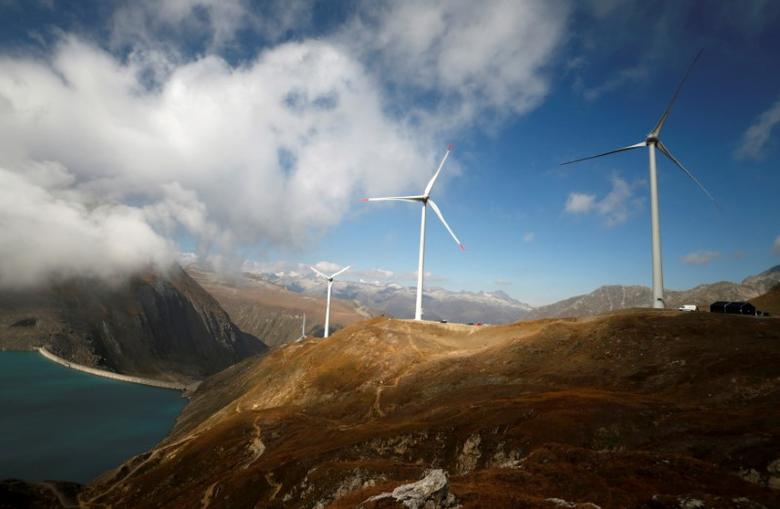 FILE PHOTO: Wind turbines are pictured at Swisswinds farm, Europe's highest wind farm at 2500m, before the topping out ceremony near the Nufenen Path in Gries, Switzerland September 30, 2016. REUTERS/Denis Balibouse/File Photo