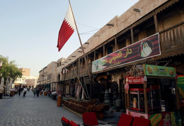 A shop with a picture of Qatar's Emir Sheikh Tamim Bin Hamad Al-Thani is seen in Doha, Qatar, June 6, 2017. REUTERS/Naseem Zeitoon