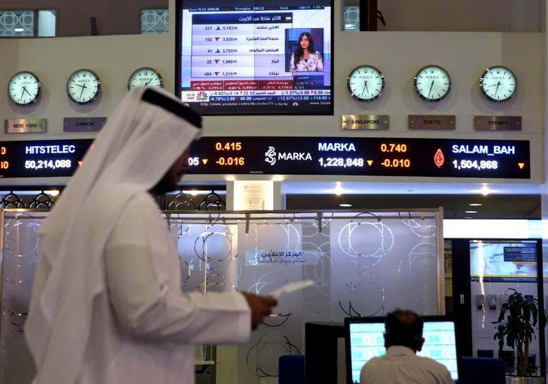 Traders monitor stock information at Dubai Financial Market, in Dubai, United Arab Emirates, June 5, 2017. REUTERS/Stringer
