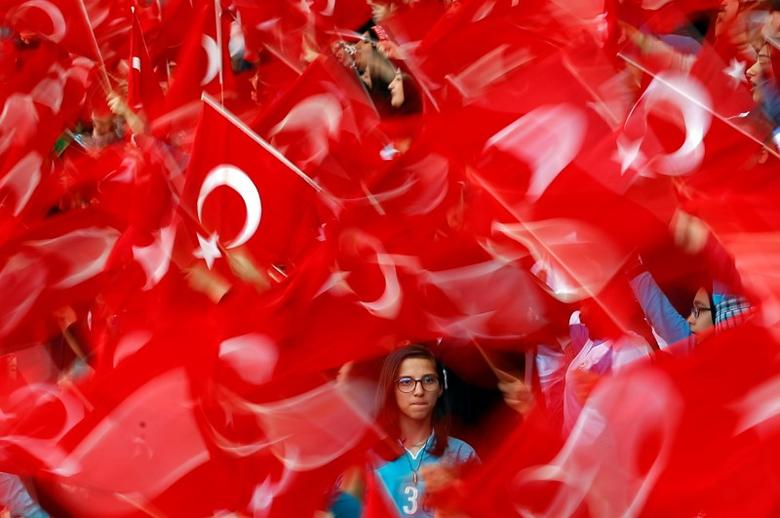 Imam Hatip religious school students wave national flags as they wait for arrival of Turkish President Tayyip Erdogan during a graduation ceremony in Istanbul, Turkey, May 26, 2017. REUTERS/Murad Sezer