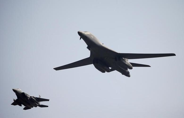 FILE PHOTO: A U.S. Air Force B-1B bomber (R) flies over Osan Air Base in Pyeongtaek, South Korea, September 13, 2016.  REUTERS/Kim Hong-Ji/File photo