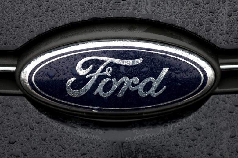 The Ford logo is pictured at the Ford Motor Co plant in Genk,Belgium December 17, 2014.REUTERS/Francois Lenoir/File Photo