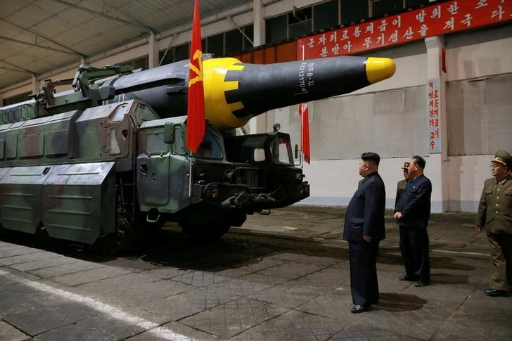 FILE PHOTO - North Korean leader Kim Jong Un inspects the long-range strategic ballistic rocket Hwasong-12 (Mars-12) in this undated photo released by North Korea's Korean Central News Agency (KCNA) on May 15, 2017. KCNA via REUTERS/File photo