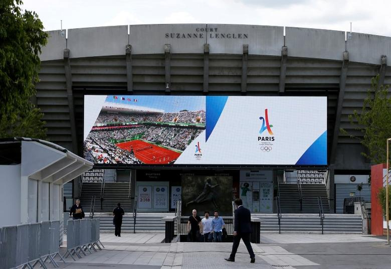 The logo of the Paris candidacy for the 2024 Olympic and Paralympic Games is displayed on a screen in the Suzanne Lenglen court at Stade Roland Garros tennis venue complex during the press tour of the International Olympic Committee Evaluation Commission, in Paris, 15 May 2017. REUTERS/Gonzalo Fuentes