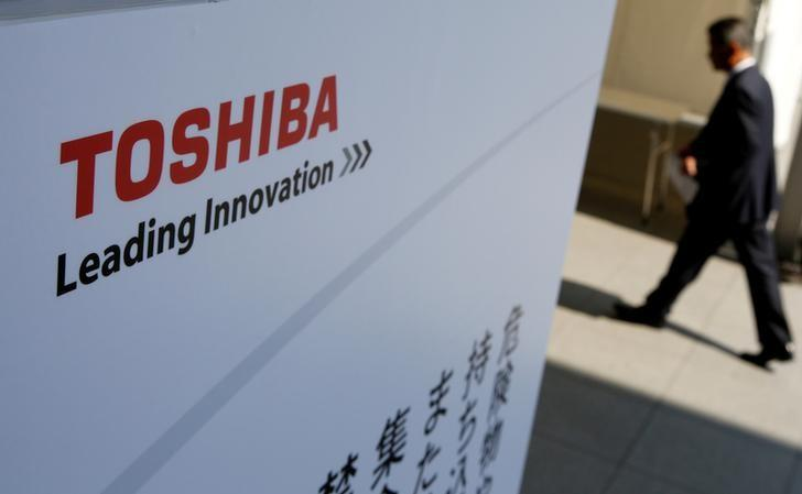 FILE PHOTO: The logo of Toshiba is seen as a shareholder arrives at Toshiba's extraordinary shareholders meeting in Chiba, Japan  March 30, 2017.   REUTERS/Toru Hanai/File Photo