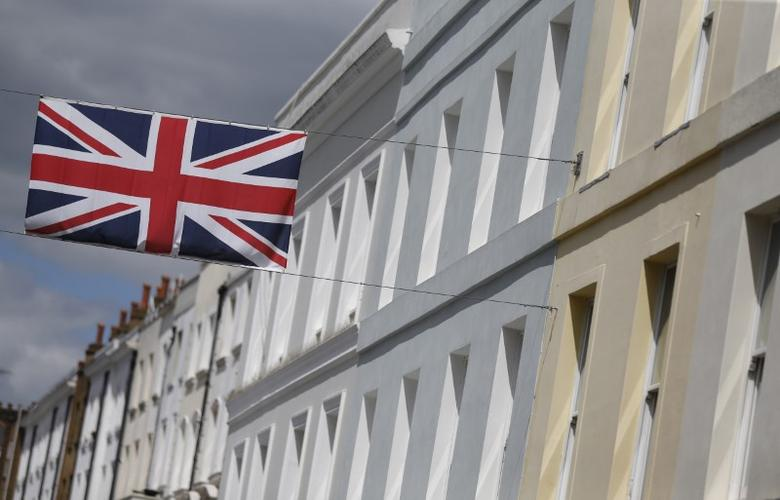 FILE PHOTO: A Union flag hangs across a street of houses in London, Britain June 3, 2015. REUTERS/Suzanne Plunkett