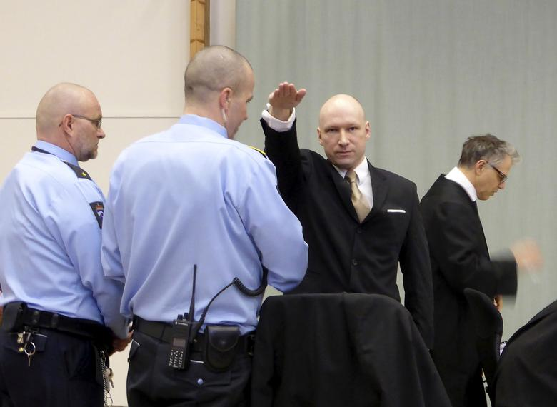 FILE PHOTO: Mass killer Anders Behring Breivik raises his arm in a Nazi salute as he enters the court room in Skien prison, Norway March 15, 2016. REUTERS/Gwladys Fouche/File Photo