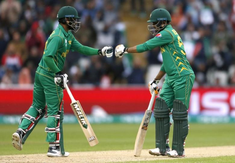 Britain Cricket - Pakistan v South Africa - 2017 ICC Champions Trophy Group B - Edgbaston - June 7, 2017 Pakistan's Mohammad Hafeez with Babar Azam after hitting a six  Action Images via Reuters / Andrew Boyers Livepic EDITORIAL USE ONLY.